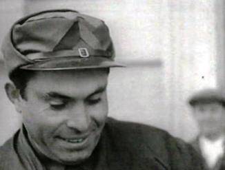 Durruti head shot with cap